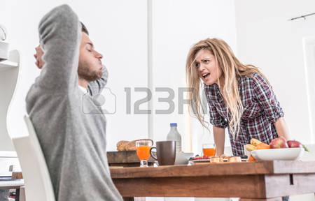 husband and wife fighting over table