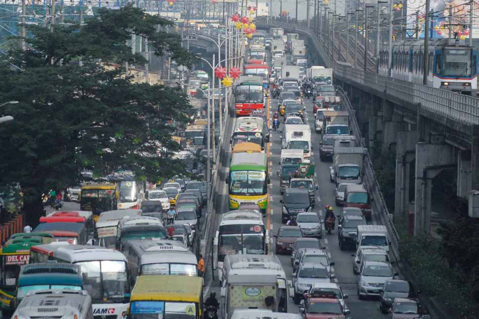 Traffic on EDSA near the Kamuning Avenue flyover is back to normal on Tuesday after the long, 5-day holiday due to the visit of Pope Francis. Despite some roads being closed for the motorcades during the papal visit, the holidays kept traffic in the metro light. Photo by Manny Palmero for ABS-CBNnews.com